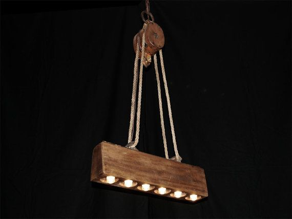 Sugar Mold / Barn Pulley Chandelier by Rustologies on Etsy, $325.00