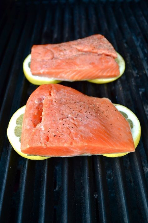 Grilled Lemon Salmon - Put lemon slices right on the barbecue and then place your salmon on top. The lemon flavor diffuses into the fish and keeps it from sticking on the grill. A healthy and unique way to cook your salmon! | twothirdscup.com