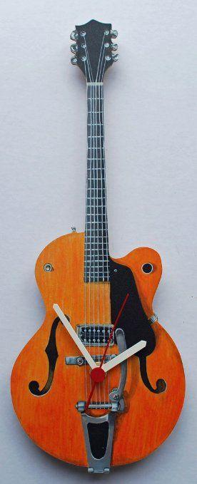 LR - Orologio da parete a forma di chitarra Gretsch EURO 20,61