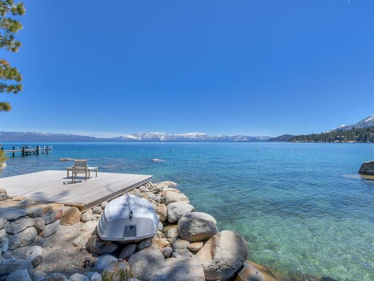 Known by many as the most romantic hideaway on the shore of Lake Tahoe. One-of-a-kind setting with full southern exposure in one of Tahoe's most private & exclusive locations with stunning views across Meeks Bay to Rubicon Peak and Mt. Tallac. #oliverlux #laketahoe #luxuryhomes #luxuryliving #takemethere #views #lakefront