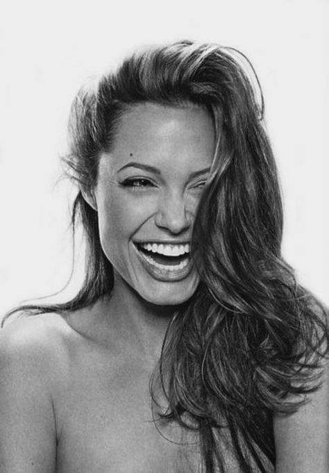 The world's most beautiful woman, with any expression. But totally transformed by laughter.