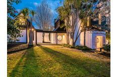 Designed by renowned architect Ian Burrow in 1975 this unique sun filled north facing expansive home has been extensively refurbished for modern living