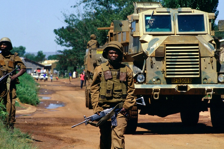 Bekkersdal Township, South Africa, Feb 1994: SADF soldiers patrol during three way clashes between security forces, ANC members and  AZAPO supporters in the far West Rand township of Bekkerdal, South Africa.