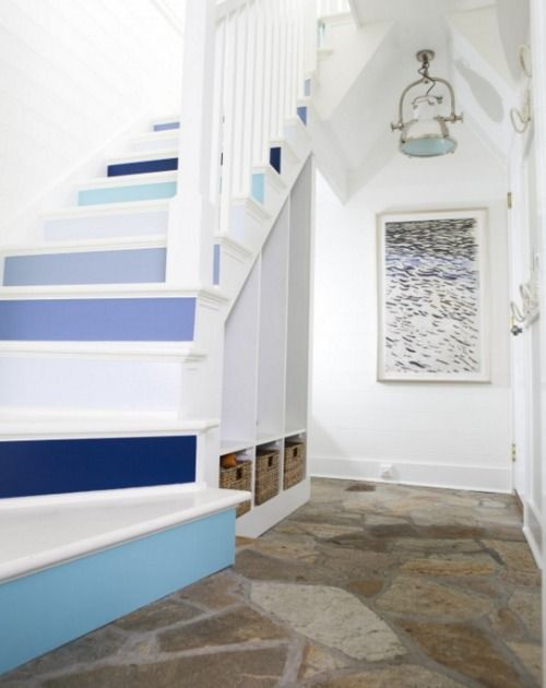 A fabulous stairway with painted risers and wardrobe with rope hooks! Check out this wow Entry here: http://www.completely-coastal.com/2016/06/gibson-island-nautical-home.html