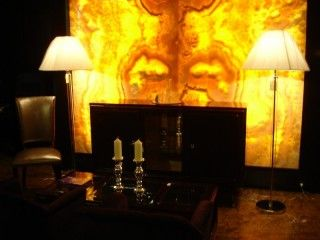 Evening lights in Montparnasse Gallery - a pair of Ralph Lauren floorlamps and the onyx wall.
