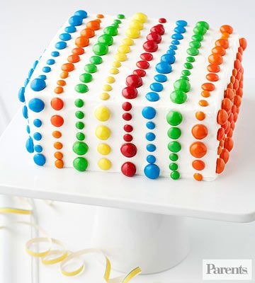 To make this colorful cake, press rows of mini, regular, and peanut M&M's into the icing in bold patterns.