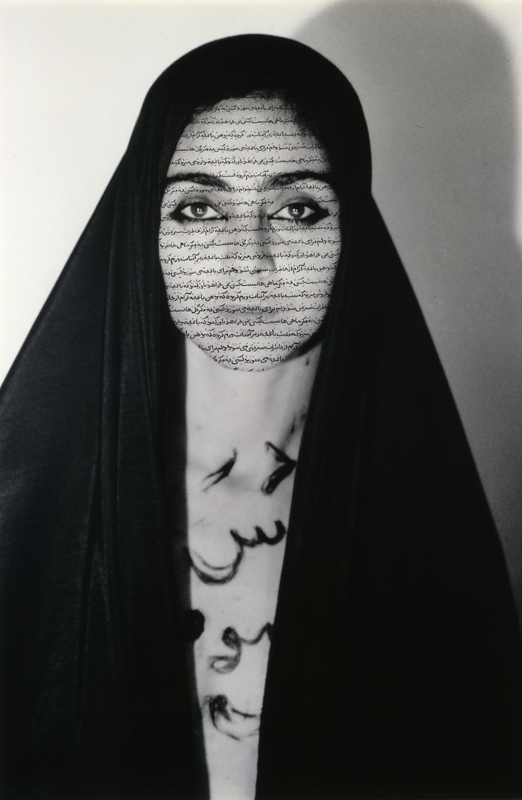 Shirin Neshat Unveiling (Women for Allah series) Photography & Ink 1994 This photograph, in the Women for Allah series, is of the artist covering herself with a traditional garb from the middle east. At the same time, she has written words on her face and chest in Arabic. The artist here works with her religious identity, and her place in it.