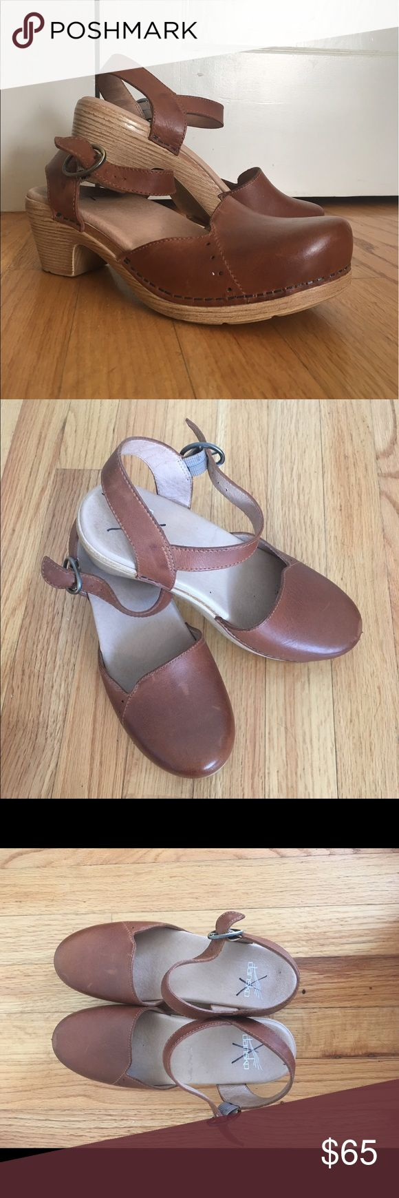 """Dansko """"Maisie"""" Mary Jane Clog (size 37) Only worn twice! In great, almost perfect condition. Bought at a sample sale (hence the black x's on the soles), and they're too narrow for my wide feet. Super, super comfortable, just too small. Brown leather with some wear and scuffs, but nothing that would prohibit you from wearing these for years to come. Very lightweight and soft. Dansko Shoes Mules & Clogs"""