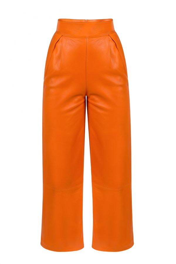 "HERMIONE PANTS  Orange leather pants are this season's ""it"" pants! They ensure the most impressive look, even though they are minimalist. Wear them with one of the label's loose tops and prepare for a comfy day in the spotlight!"