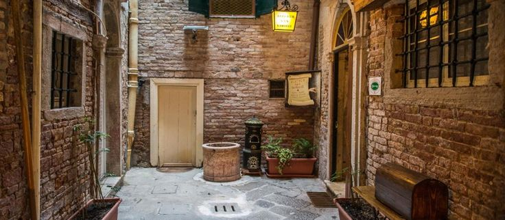 You enter in an old palace in #Venice. Suggestive atmosphere. It is our small and nice Hotel.    #venice #bookanhotel #budgethotelinvenice