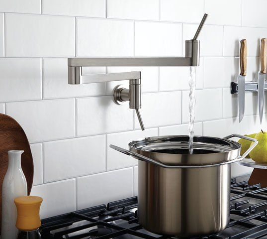Sleek and geometrical, the new Contemporary pot filler from DXV by American Standard redefines savvy modern design and smart functionality. Dual controls—one on the wall, the other on the pullout—enhance convenience, as does the two-piece adjustable arm, which tucks away neatly when not in use. $1,095 to $1,259. #kitchens #architecture #design