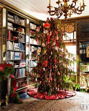 LIBRARY A weeping Alaskan cedar follows the room's Far Eastern theme, from its swooping silhouette (a favored element in Chinese gardens) to ornaments shaped like lanterns, dragons, and snuff bottles; the embroidered tree skirt was specially made from Chinese wedding silk.