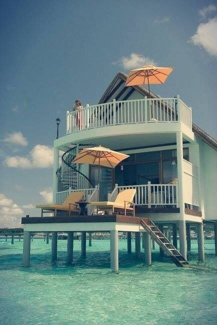 Beach home or Home in the water or boat house, but is this really a boat?  Either way it would be amazing! Vacation HOME!