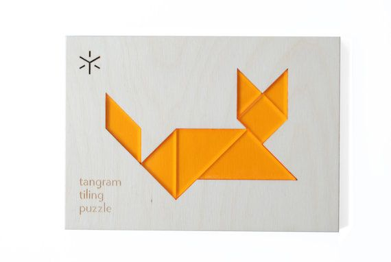 Animal-themed tangram puzzle is a playful new take on a timeless favorite. this puzzle is composed of a sturdy wooden frame into which a clear tangerine, classic tangram puzzle set nests to form the shape of a sleepy cat. outside of the elegant frame, each seven piece classic puzzle set can be used to create countless challenges and solutions. each set includes a beautiful, full color pamphlet with additional puzzles! $18 by Bright Beam
