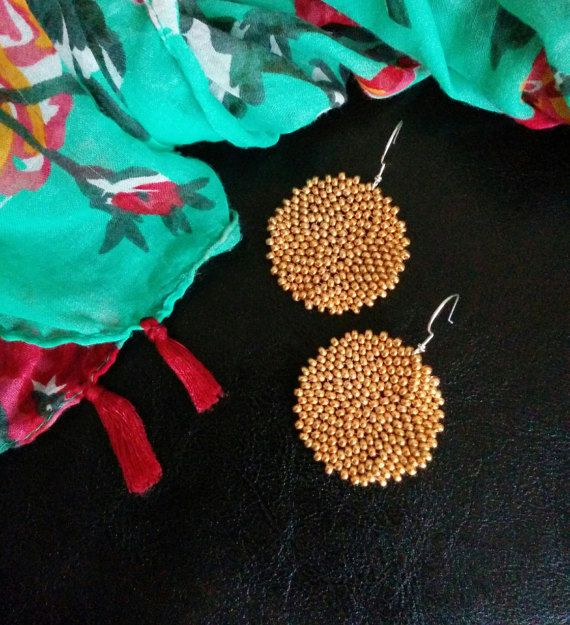Delicately hand woven golden beaded earrings with handmade sterling silver earring hooks. These earrings are very stunning when worn - my customers get so many compliments when wearing them. When the light shines just right, you will see a beautiful lacy pattern emerge. Each