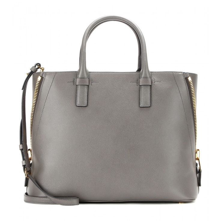Tom Ford - Leather shopper - For a classically sophisticated choice, make this Tom Ford leather shopper your go-to bag day or night. The grainy grey leather is embellished with oversize gold-tone zippers - a luxe detail that ensures an elegant edge. Sling it over your shoulder as you rush to catch a flight, or fill it with work essentials for a day at the office. seen @ www.mytheresa.com