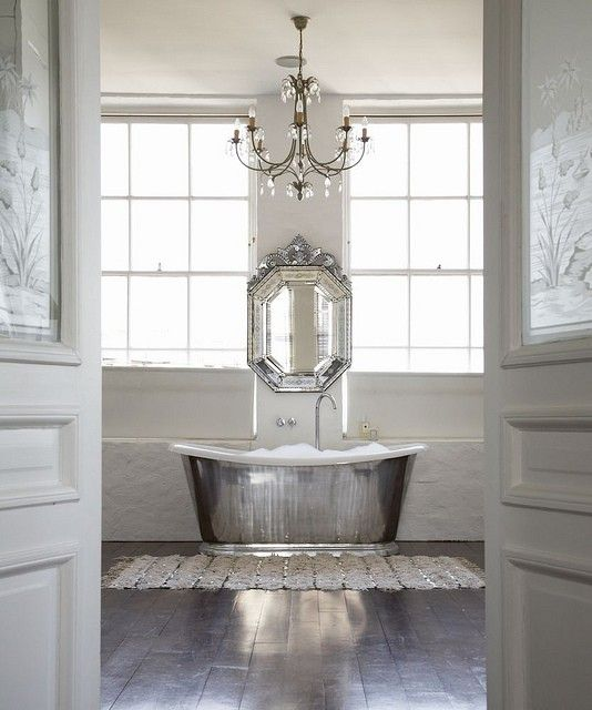 Silver & white scheme. Gorgeous silver bath. Love the way mirror, chandelier & bath all in a line