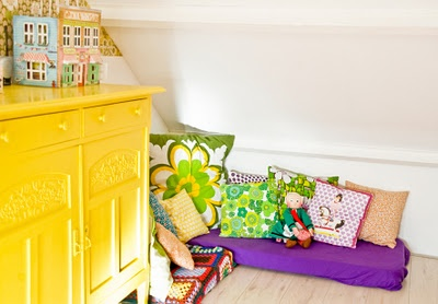 cute little corner… lots of fun pillows for a colorful reading nook