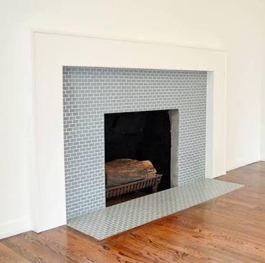 Image result for modern tiled fireplace