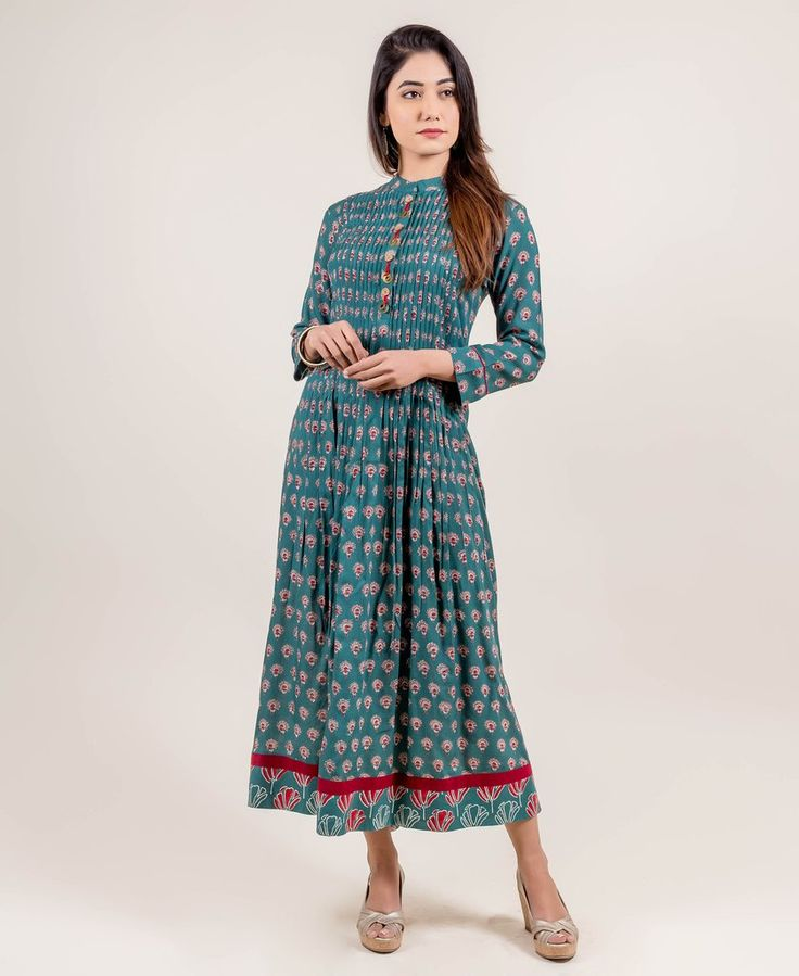 Delight your senses and other's too when you #dress up in this splendidly gorgeous long #teal dress with #handblockprints from the house of #missprintclothing. With a Mandarin neckline, quarter sleeves, front and back pleated waistline, front placket and red butti prints, it is sure to make you feel as effervescent as your carefully crafted libations.