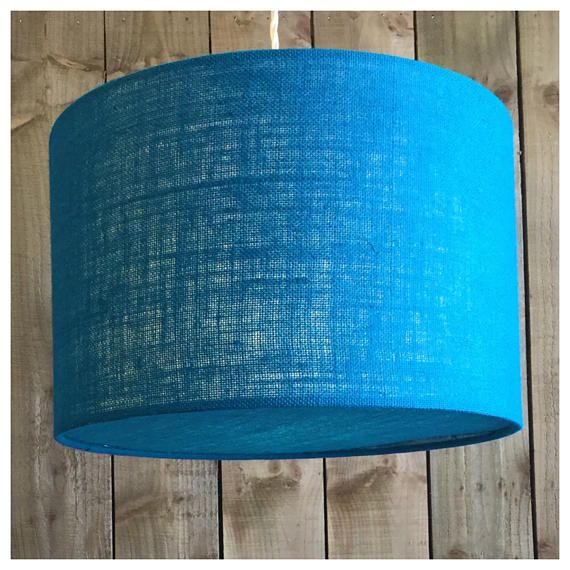 This stylish hessian lightshade & coordinating diffuser is handmade in our Bristol workshop from hessian fabric in blue ▪️Need a swatch of this fabric? Please order from this listing- https://www.etsy.com/uk/listing/514198455/sample-of-fabric ▪️Fabric - blue Hessian ▪️Made to order within 5 working days ▪️ Measures - Various Sizes ▪️Diffuser included. Diffusers are perfect for when shades are hung from high ceilings, they draw the eye to the shade design ra...