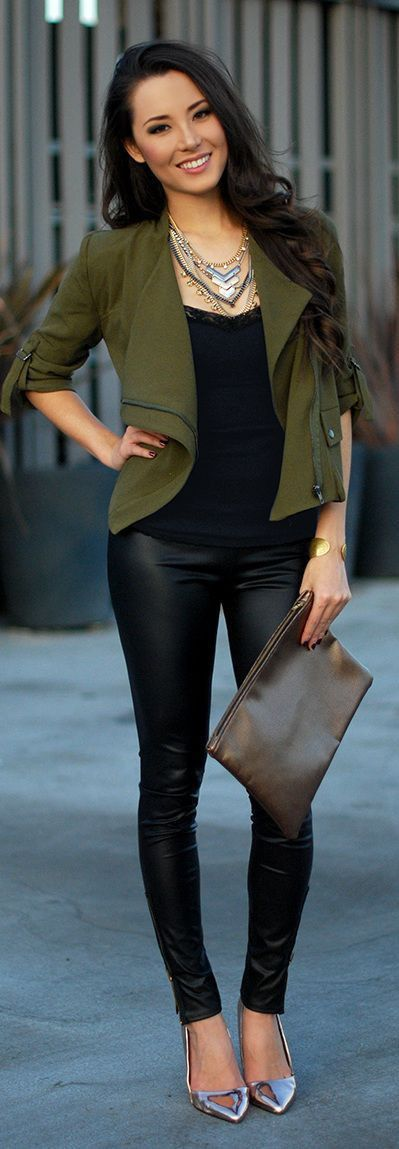 Stylish outfit - Black leggings, black shirt, green blazer, pointed high heels, clutch & necklaces.