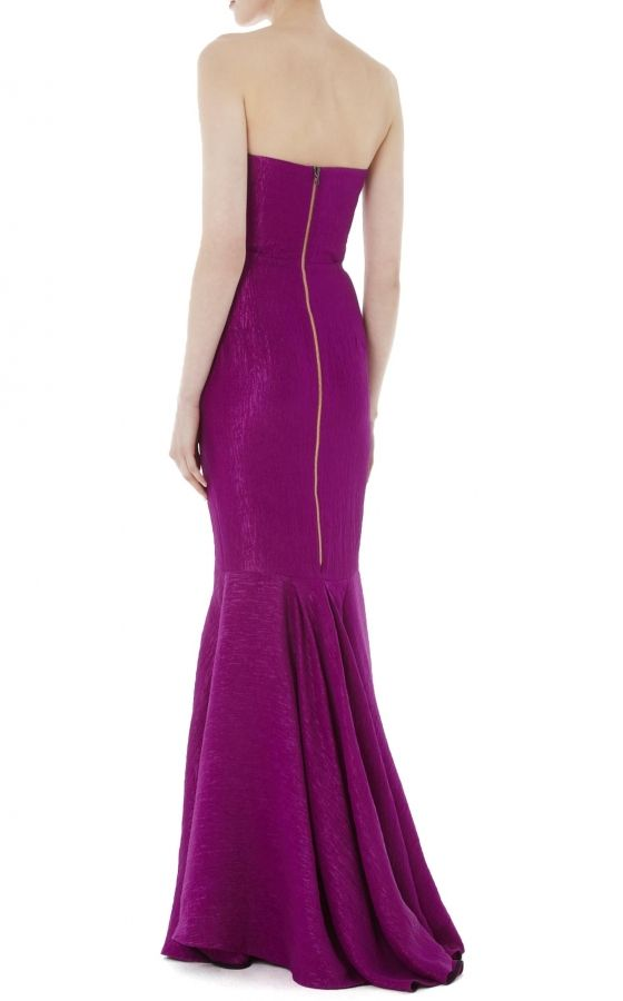 The Roland Mouret Odell Gown in bright violet puckered striped organza creates a statuesque column silhouette sure to turn heads. The strapless bodice features Roland's signature darted folds, while the floor-length skirt showcases a dramatic bias-cut mermaid hem. This curve-hugging dress fits and flatters with rich texture and a hue signature of the season.
