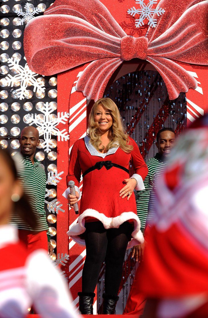 """Pin for Later: Nobody Does Christmas Quite Like Mariah Carey  In 2010, a pregnant Mariah performed """"Oh Santa"""" and """"All I Want For Christmas Is You"""" at Disney's Magic Kindgom in Florida."""