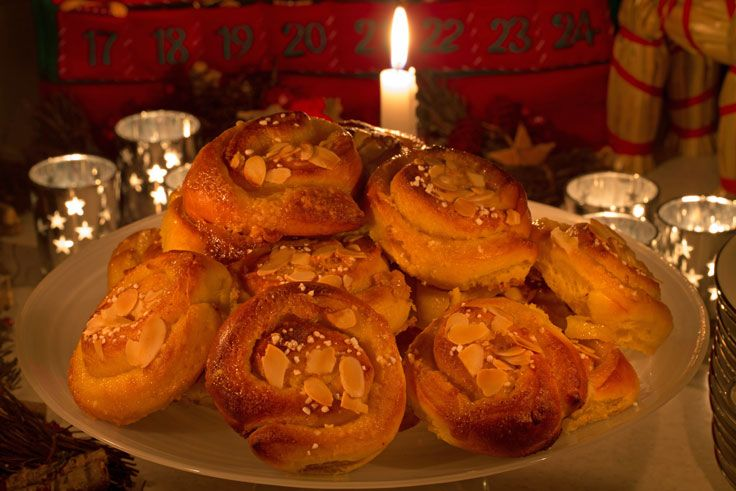 Saffron buns are enjoyed throughout Sweden during December. They are particularly nice when eaten by candle light with a mug of hot chocolate or a glass of glögg! The most common form is as lussekatter in which the buns are shaped in spirals with two raisins,  but these have almond paste inside and they are a popular alternative.