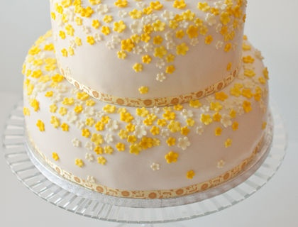 First Communion cake with  yellow flowers.