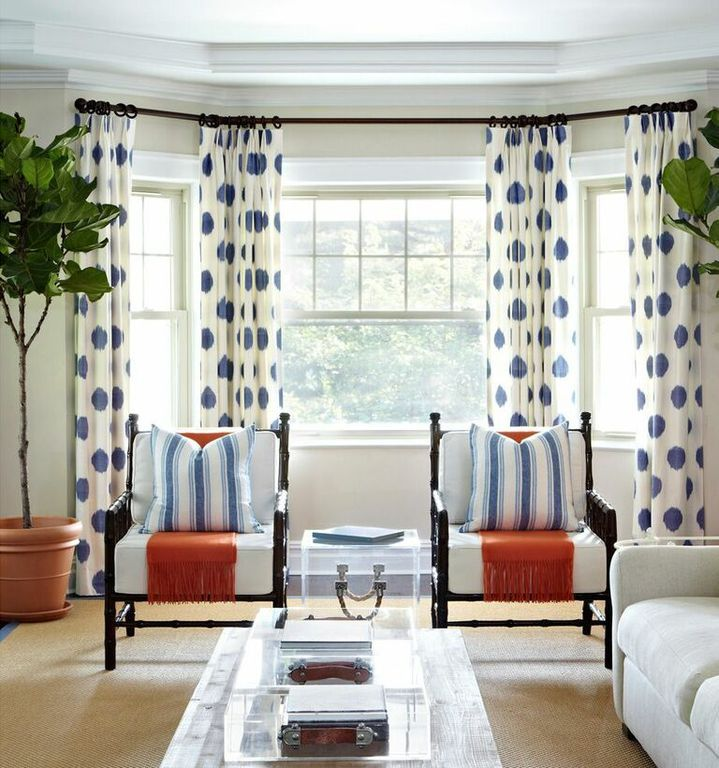 living room with curtains polkadot navy on white carpet