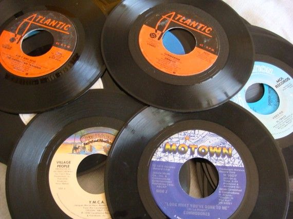 "45s. I remember my first record player I got for Christmas and I got 45s of Donna Summer's ""Dim All the Lights"" and "" Pop Muzik"" a 1979 hit song by M, a project by Robin Scott. I played them over and over."