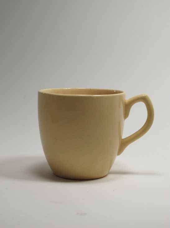 cup, clear glaze over oatmeal body, earthenware, Crown Lynn, 1940s, Auckland, New Zealand. Collection of Auckland Museum