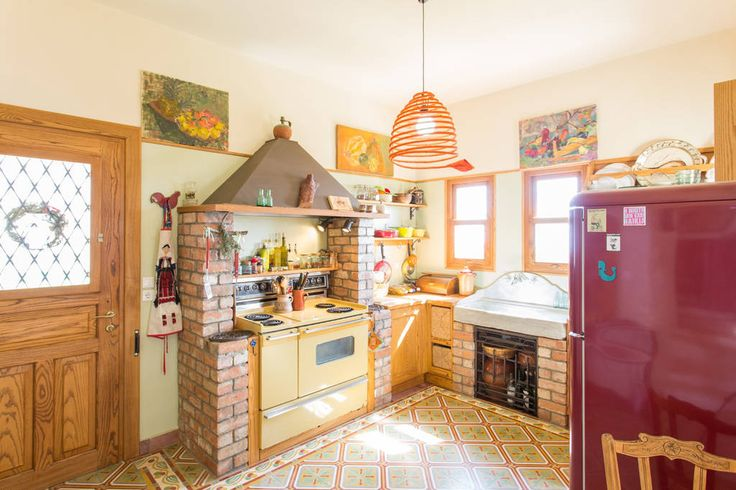 Bright fully equipped kitchen, notice the handcrafted floor tiles ... the door leads outside, to the kitchen veranda ...