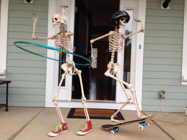 halloween ideas for the month of october til halloween my dad changes up the scene of these 2 skeletons on his front porch each day for the neighbors to