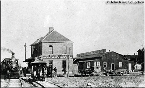 An Ohio River Railroad passenger train is seen here at the Huntington, West Virginia station circa 1895. Note the ORRR's name on the side of both the passenger and freight stations. This town marked the southern terminus of this railroad and in just a few years it was taken over by the B.