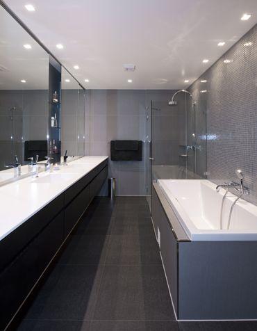 Elegant bathroom in black tiles. Interior architecture | Ramsoskar