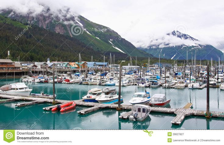 A view of the Seward waterfront and a part of the Small Boat Harbor with Mount Benson nearby and the Resurrection Peaks looming in the background. Description from dreamstime.com. I searched for this on bing.com/images