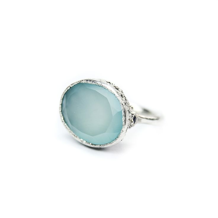 Stoned Collection    Big, organic and light ring that allows light beautifully seep through due to translucency of the stone that is meticulously surrounded by a lace body. One sapphire on each side.    Stone size: 20mm x 16mm