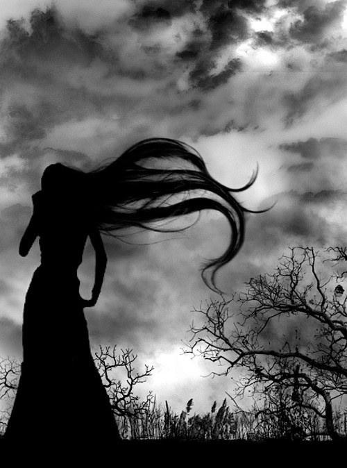 Hair blowing in the wind.