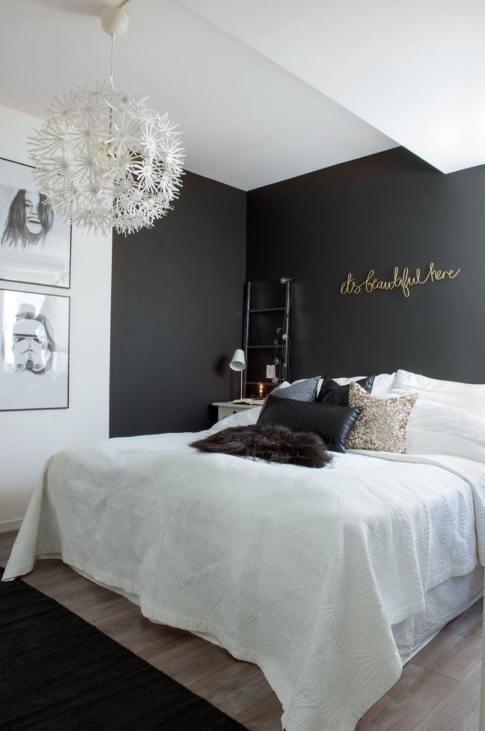 So much modern elegance in the bedroom of this Norwegian house. The deep black accent wall,