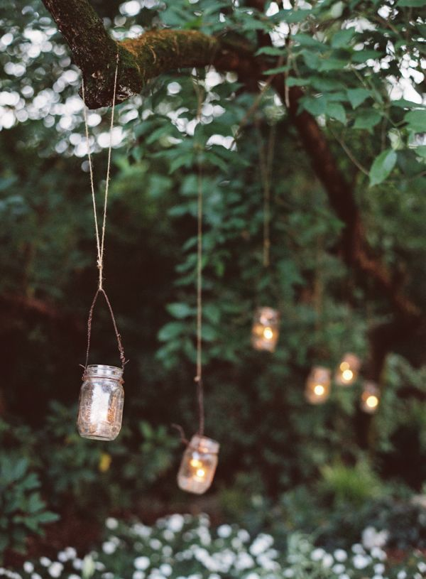 the hanging mason jars with candles all over the cedarwood property is one of the whimsical rustic touches i just adore this soft lighting adds a glow to adore diy hanging mason