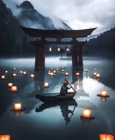 Japan lake with lanterns on the water and mountains with clouds.   #japan #travel #instagood