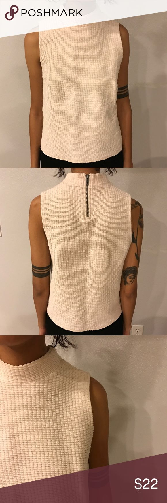 Quilted Topshop Top Super cute and soft cream quilted mock neck tank! Features a zipper on the back of the neck. Great versatile piece for the winter and spring! Topshop Tops Tank Tops