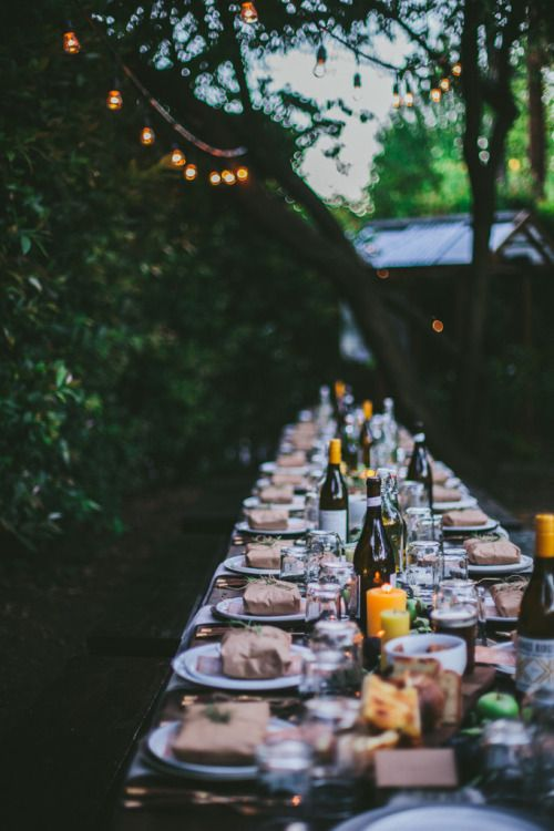 Tablescape inspiration for entertaining outdoors, complete with with twinkle lights and bench tables.   Macadameia