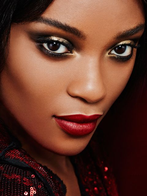 Eye makeup on point. Her bold eye shadow is everything.