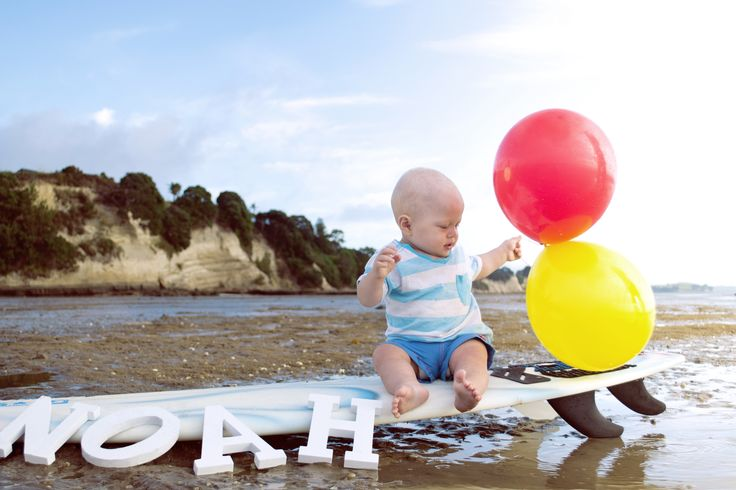 Beautiful surfer boys first birthday photoshoot taken at Eastern Beach  by Hyped
