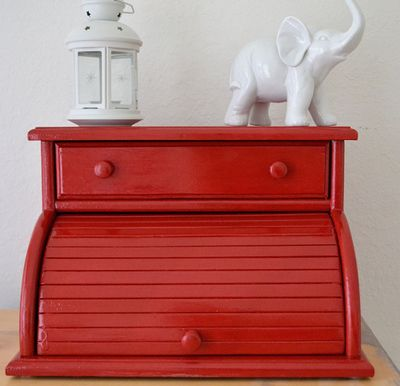 Apply multiple thin coats of paint in your choice of color to transform your bread box into a modern home accent.