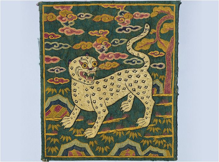 """Military Officer's Insignia, with a Tiger Design Embroidery  Joseon dynasty  Insignia with a tiger design was worn by low-ranking military officers. The tiger is expressed like a caricature, with bamboo leaves arranged at the bottom. The tiger is..."