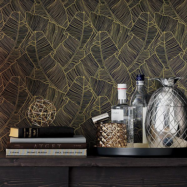 I'm obsessed with the idea of this wallpaper in our hall half-bath.  CB2 palm navy and gold self-adhesive wallpaper